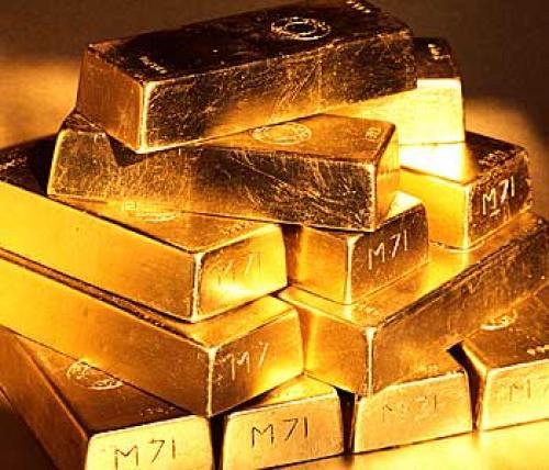 هبوط العقود الأجلة للذهب على خلفية ارتفاع الدولار مقابل اليورو
