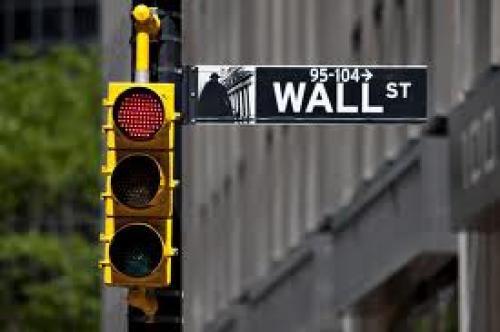 وول ستريت تتذبذب عقب قرار المركزي الأوروبي وبيانات أمريكا
