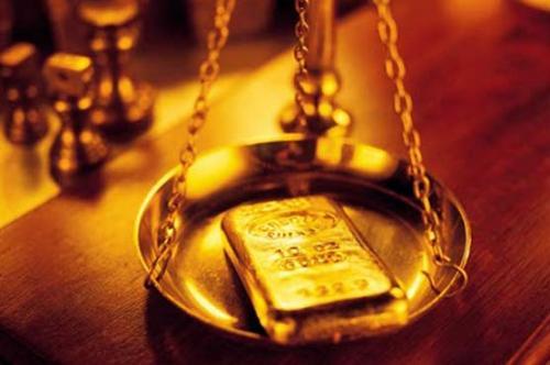 العقود الآجلة للذهب تتراجع نظرًا لقوة الدولار