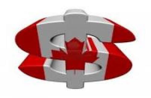الدولار الكندي يتراجع في ضوء ضعف بيانات مبيعات الجملة