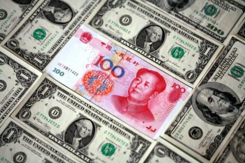 بنك الصين يحدد سعر صرف اليوان عند 6.8053