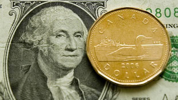 الدولار كندي يُقلص خسائره